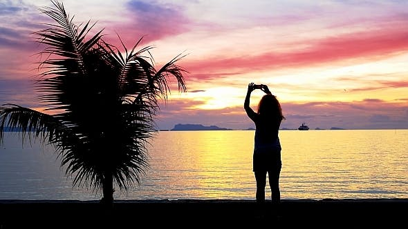 Thumbnail for Girl Photographs Beautiful Sunset