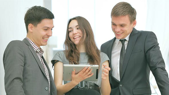 Several Young People Smiling with iPad