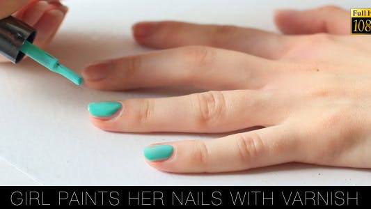 Thumbnail for Girl Paints Her Nails With Varnish