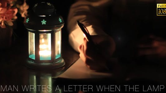Thumbnail for Man Writes A Letter When The Lamp