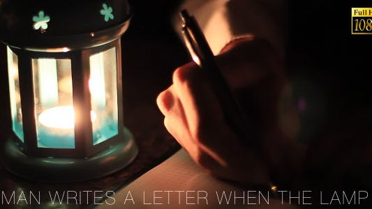 Cover Image for Man Writes A Letter When The Lamp 2