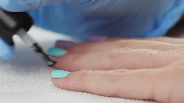 Thumbnail for Young Woman Paints Her Nails with Protective Layer Base. Nails Manicure.