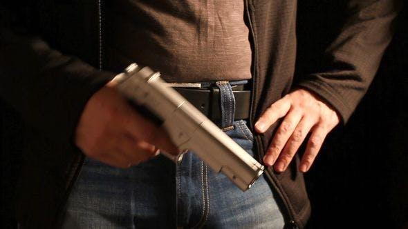 Thumbnail for Man Holding A Gun, Reloads It