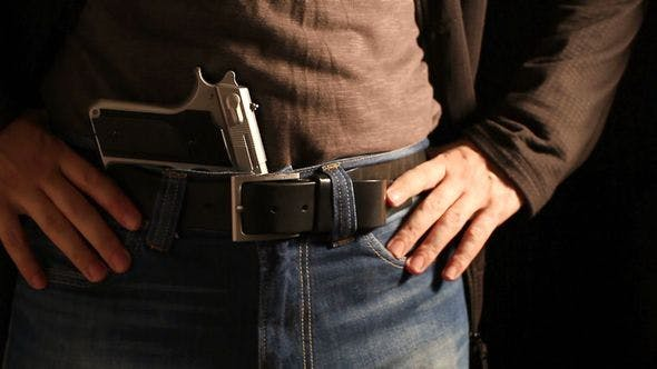 Thumbnail for Man Reloads The Gun And Puts It In His Belt