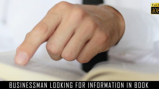 Cover Image for Businessman Looking For Information In Book