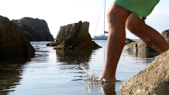 Walk Through the Beach Splashing Water
