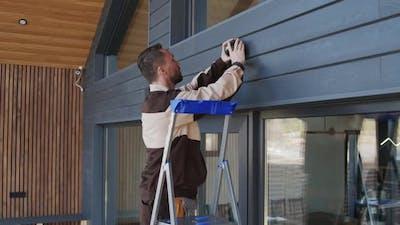 Handyman Installing Home Security Camera