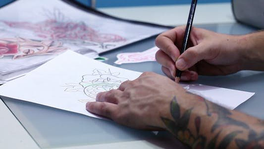 Thumbnail for Artist Drawing Tattoo Sketch