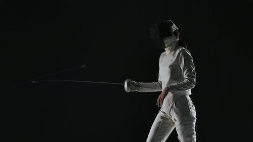 Side View of Professional Fencers Demonstrating Mastery of Foil Fencing