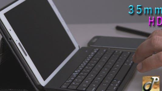 Man Hands Using Tablet Keyboard