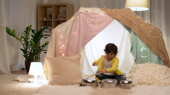 Thumbnail for Boy with Pots Playing Music in Kids Tent at Home