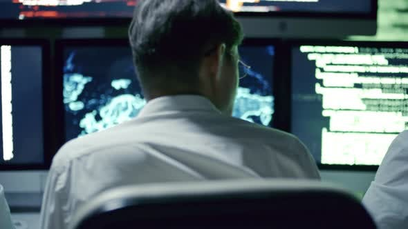 Cover Image for IT Security Team Working at Night