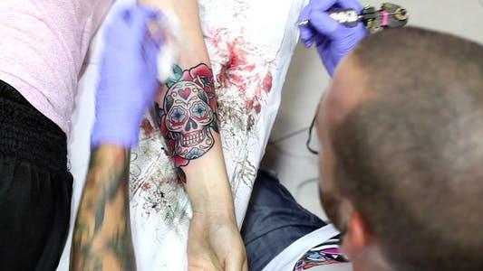 Artist tattooing Old School Tattoo