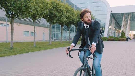 Thumbnail for Businessman with Backpack in Formal Clothes Riding a Bicycle to His Office