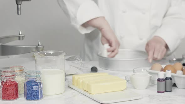 Thumbnail for Time lapse. Step by step. Greasing cake pans with butter to bake a three-layer vanilla cake.