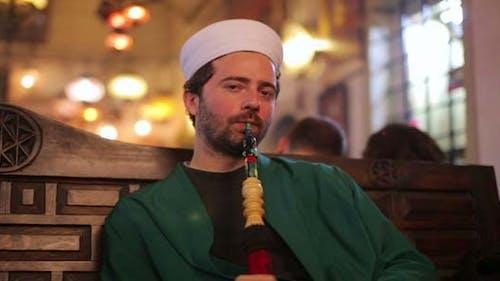 Islamic Man With Traditional Dress Smoking Shisha