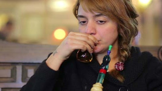 Secular Turkish Woman Smoking Shisha