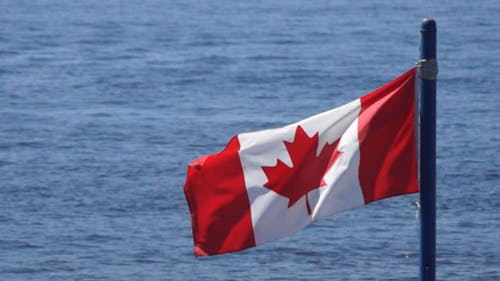 Canada Flag On Water