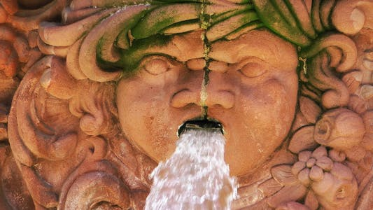 Thumbnail for Waterfall and Ancient Woman Head Statue