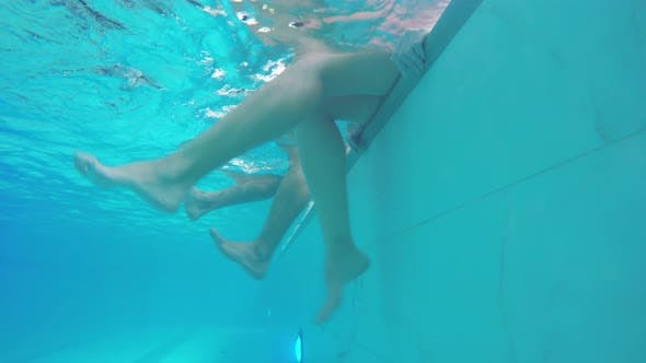 Thumbnail for Female and Male Swimmers Swinging Legs in Water