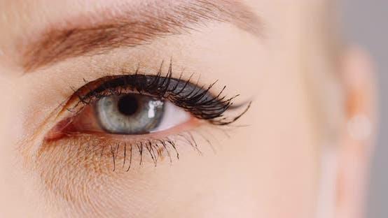 Thumbnail for Macro Shot of Blue Eye Opening Human Iris. Womans Eye.