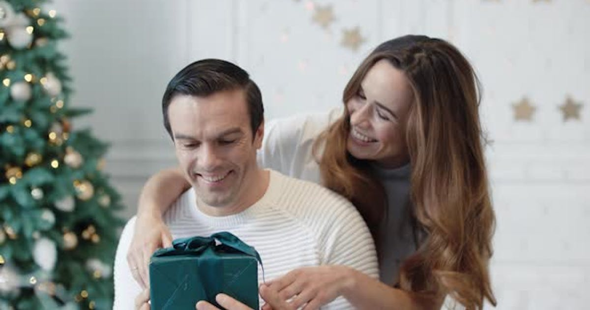 Cheerful Man Getting New Year Gift in Luxury House