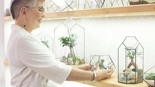 Senior Modern Florist Woman Look After Plants in Capsule