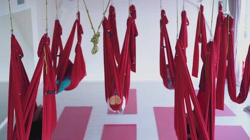 Fly Yoga Class with Ladies Recovering Energy in Hammocks