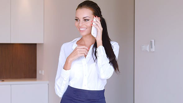 Thumbnail for Beautiful Young Businesswoman Talking Mobile Phone