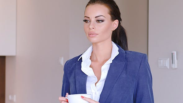 Thumbnail for Beautiful Young Businesswoman With Cup Of Hot Coffee