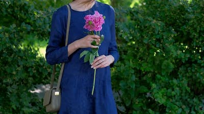 Young Woman with Peony Flower
