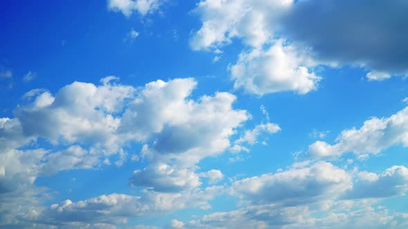 Thumbnail for Time Lapse White Fluffy Clouds Over Blue Sky 4