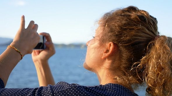 Thumbnail for Girl Taking Photo of Island by Smart Phone