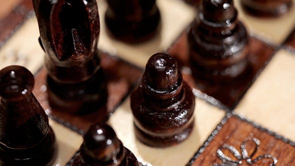 Thumbnail for Black Chess Pieces On A Board