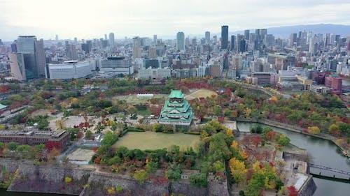 Osaka castle and building city at Osaka, japan in autumn.
