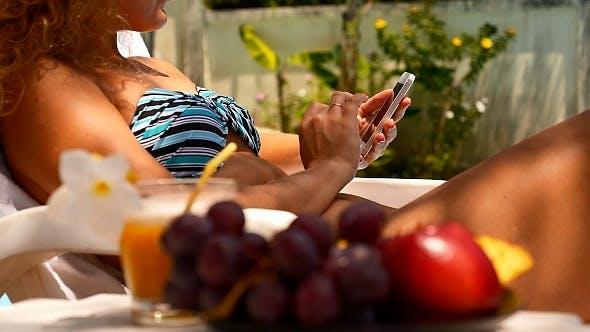 Thumbnail for Woman in Bikini with iPhone