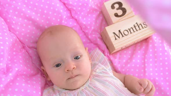 Thumbnail for Three Months Baby Girl in Pink Bassinet