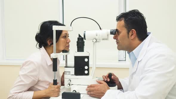 Thumbnail for A Skilled Doctor Examines the Patients Eyes with a Device