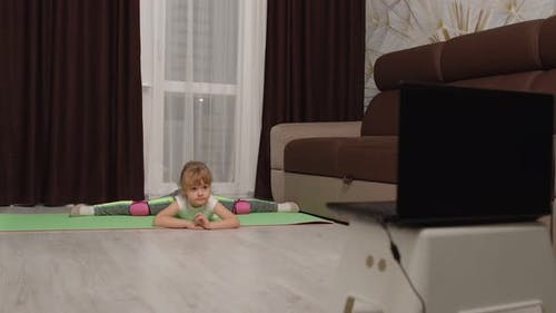 Child Kid Girl Doing Gymnastics Fitness Stretching Twine at Home Video Tutorial Distance Training