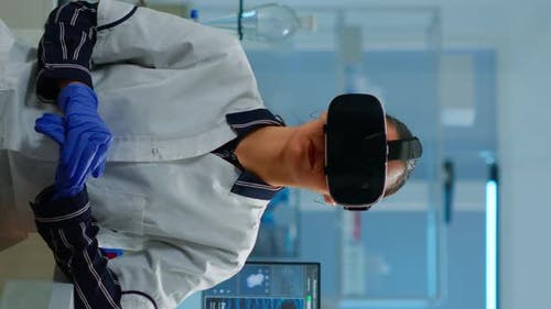 Vertical Video Laboratory Doctor Experiencing Virtual Reality Using Vr Goggles