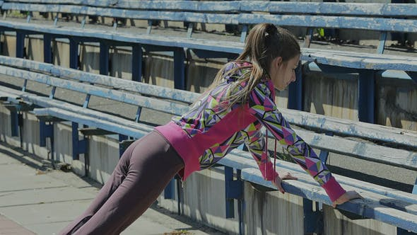 Thumbnail for Young Girl Doing Gymnastics Exercise at the Stadiu