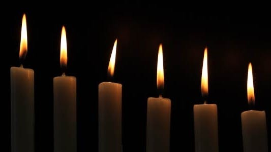 Cover Image for Candles On A Black Background
