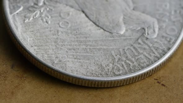 Rotating stock footage shot of antique American coins - MONEY 0076