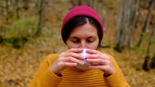 Closeup Woman Hiking Traveler Drinking Hot Tea and Relaxing