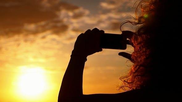 Thumbnail for Taking Photo of Dramatic Sunset