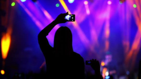 Thumbnail for Girl with a Smartphone at a Rock Concert