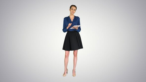 Thumbnail for Lady with short hair wearing formal clothes holding a tablet