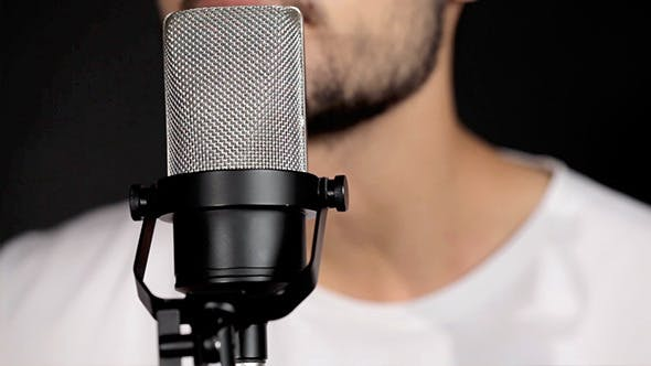 Thumbnail for Men Singing At Microphone