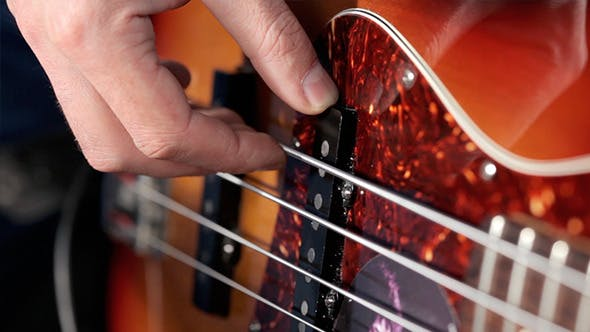 Thumbnail for Bass Player Playing With Strings