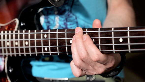 Thumbnail for Men Playing On Bass Close Up